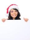Unga kvinnliga tonåriga santa hat behind white board Arkivfoto