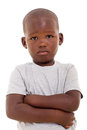 Unhappy african boy little with arms crossed on white background Royalty Free Stock Photos