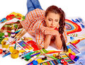Unhappy artist woman lying on paint palette Royalty Free Stock Photo