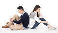 Unhappy asian couple young sit on ground back to back with expression on studio white background Stock Photography