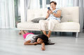 Unhappy Asian girl lying down on wooden floor Royalty Free Stock Photo