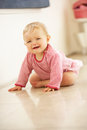 Unhappy Baby Girl Sitting On Floor Crying Royalty Free Stock Photography