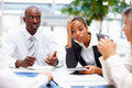Unhappy business team at a meeting Stock Images