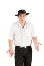 Unhappy businessman in hat gesturing Royalty Free Stock Photos