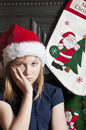 Unhappy christmas child portrait of a young with an face Stock Image