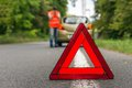 Unhappy driver and broken car on the road Royalty Free Stock Photo