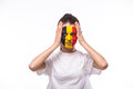 Unhappy and failure of goal or lose game emotions of belgian football fan in game supporting of belgium national team on white Royalty Free Stock Photo