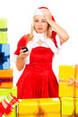 Unhappy female Christmas Santa with mobile phone Royalty Free Stock Photos