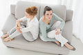 Unhappy female friends not talking after argument on the couch high angle view of young at home Royalty Free Stock Photos