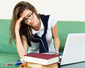 Unhappy girl behind her laptop Royalty Free Stock Photo