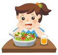 Unhappy girl doesn`t want eat healthy vegetables.