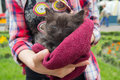Unhappy homeless kitten in the hands of a volunteer Royalty Free Stock Photo