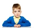 Unhappy little boy in blue cardigan and yellow shirt Stock Photography