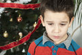 Unhappy little boy on christmass Stock Photos
