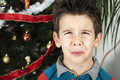 Unhappy little boy on christmass Stock Photography