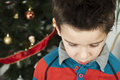Unhappy little boy on christmass Stock Images
