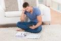Unhappy man calculating finance young at home Stock Photos