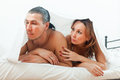 Unhappy man has problem under sheet men with wife in bed Royalty Free Stock Images