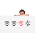 Unhappy men man holding poster with four lamps Royalty Free Stock Photos