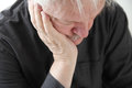 Unhappy older man slumped in depression or grief Royalty Free Stock Photography