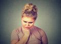 Unhappy overweight woman depressed looking down. Human face expression emotion