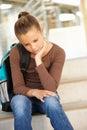 Unhappy Pre teen girl in school Royalty Free Stock Photo