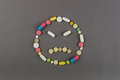Unhappy smile created from colored pills. Medical concept Royalty Free Stock Photo