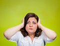Unhappy stressed woman covering ears looking up Royalty Free Stock Photo