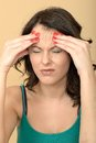 Unhappy stressed young woman with a painful headache dslr royalty free image hands on forehead or migraine looking away Royalty Free Stock Images