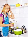 Unhappy tired woman at kitchen preparing food Royalty Free Stock Images