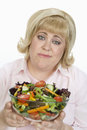 Unhappy Woman Holding Bowl Of Salad Royalty Free Stock Images
