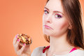 Unhappy woman holds cake in hand Royalty Free Stock Photo