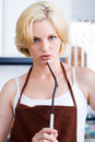 Unhappy woman in kitchen Stock Photo