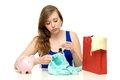 Unhappy woman with shopping bags and piggybank Royalty Free Stock Photo