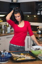 Unhappy woman standing in kitchen beautiful Royalty Free Stock Photo