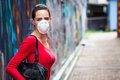Unhappy woman wearing face mask a on a street a looking upset Royalty Free Stock Photo