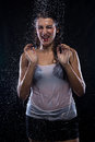 Unhappy young brunette under running water Royalty Free Stock Photo