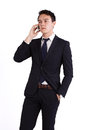 Unhappy young caucasian business man holding mobile phone male businessman looking a looking away from camera Royalty Free Stock Photo