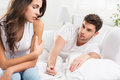 Unhappy young couple in bedroom portrait of heterosexual Stock Images