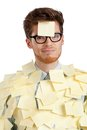 Unhappy young man with a sticky note on his face, covered with stickers Royalty Free Stock Photos