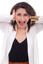 Unhappy young woman covering her ears and screaming portrait of a isolated on white background Stock Images