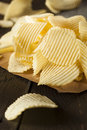 Unhealthy crinkle cut potato chips ready to eat Royalty Free Stock Image
