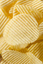 Unhealthy crinkle cut potato chips ready to eat Royalty Free Stock Photography