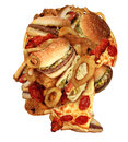Unhealthy diet health concept with a group of greasy fast food in the shape of a human head as a symbol of dangerous eating Royalty Free Stock Image