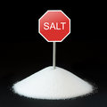 Unhealthy food concept salt and road sign Stock Image