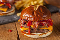 Unhealthy homemade barbecue bacon cheeseburger with fries Royalty Free Stock Image
