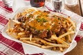 Unhealthy messy chili cheese fries on a background Royalty Free Stock Photos