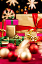 Unicolored Xmas Presents Between Baubles and Stars Royalty Free Stock Photo