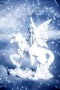 Unicorn with elf fairy Stock Photo