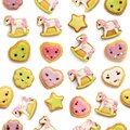 Unicorn and heart shaped sugar cookies decorated with pastel royal icing on white background Royalty Free Stock Photo